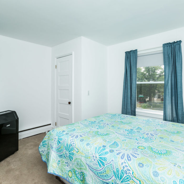 42 Admiral Boulevard blue bedroom