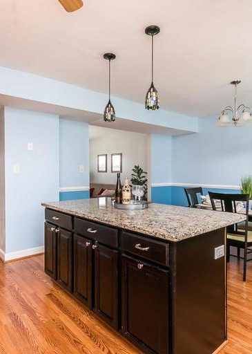3 Kintore Ct. kitchen with island and light fixtures