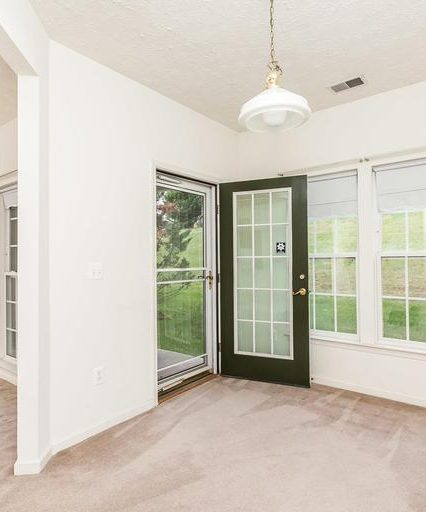 5076 Brightleaf Ct. dining room exit door