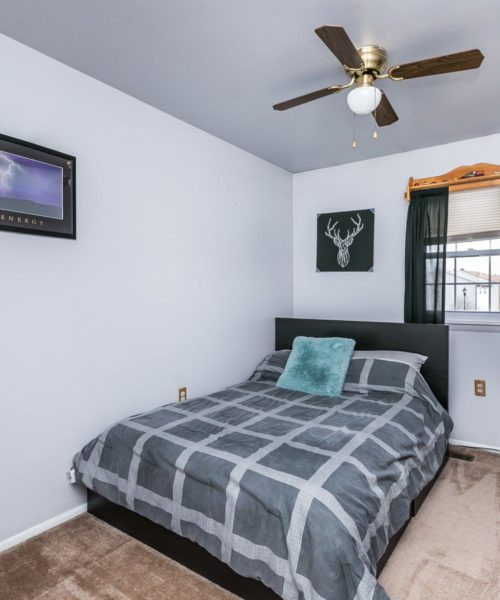 90 King Charles Circle bedroom with ceiling fan