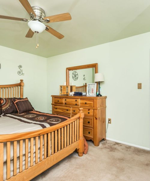 90 King Charles Circle bedroom 2 with ceiling fan
