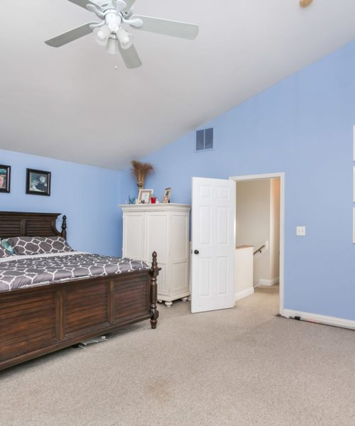 3919 Briar Point Road bedroom with ceiling fan