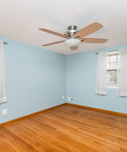 4416 Springwood Ave. bedroom with ceiling fan