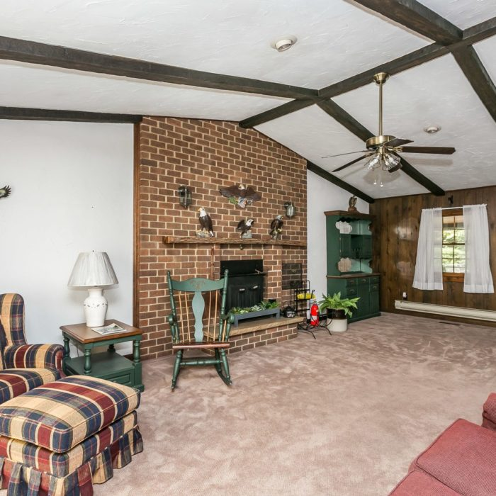 201 Janet Ct. den with ceiling fan, exposed beams