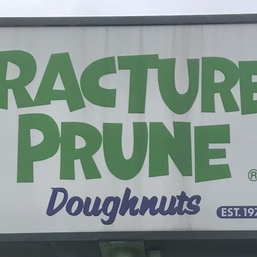 Fractured Prune Doughnuts sign