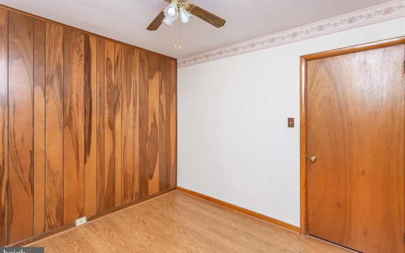 719 50th Street bedroom with wood paneling