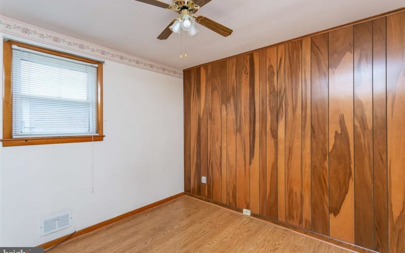 719 50th Street, bedroom ceiling fan and wood panel wall