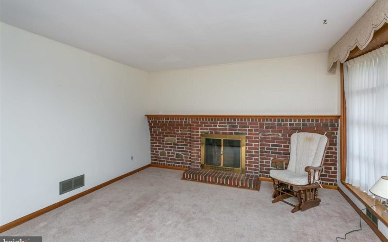 719 50th Street fireplace and wall of windows