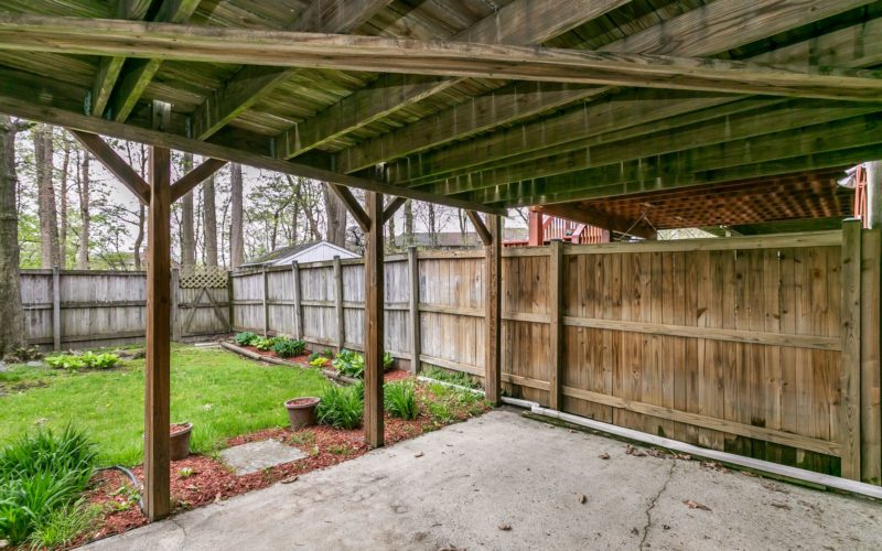 8673 Castlemill Circle, patio under deck with fenced yard