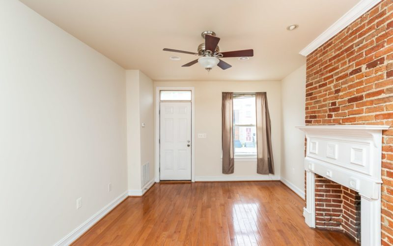 2012 Gough Street, living room with ceiling fan and exposed brick