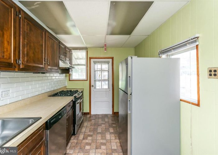 316 Drew St., kitchen with cabinets and back door