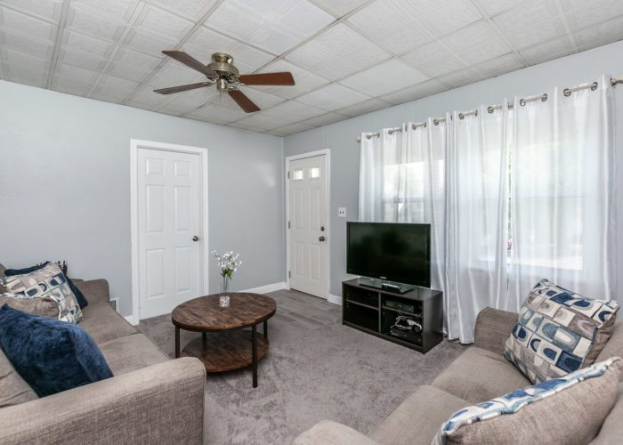 6536 Corkley Road, living room with ceiling fan