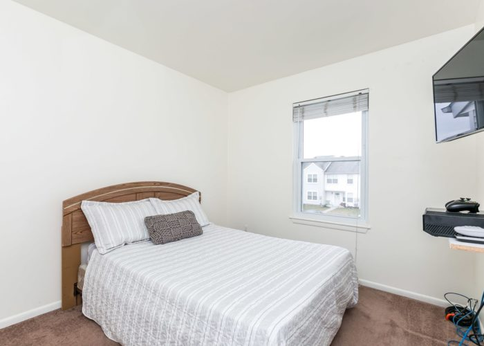 36 Nakota Court, second bedroom with brown carpet