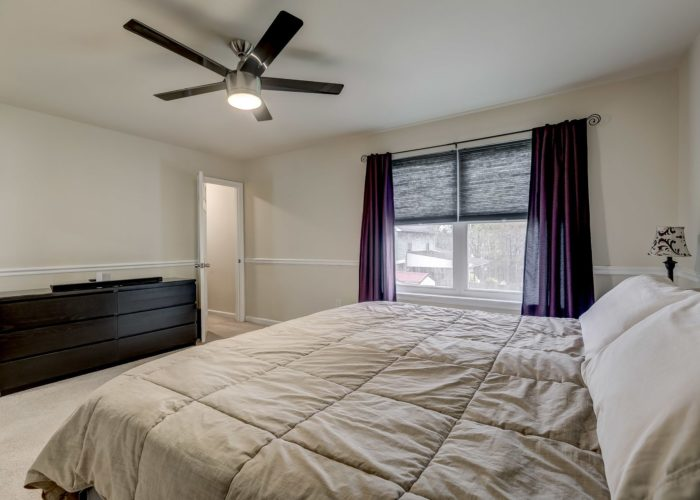 3009 Lilac Court, master bedroom with ceiling fan