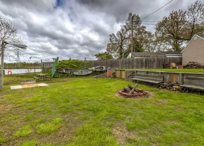8134 Bullneck Road, back yard with benches and fire pit.