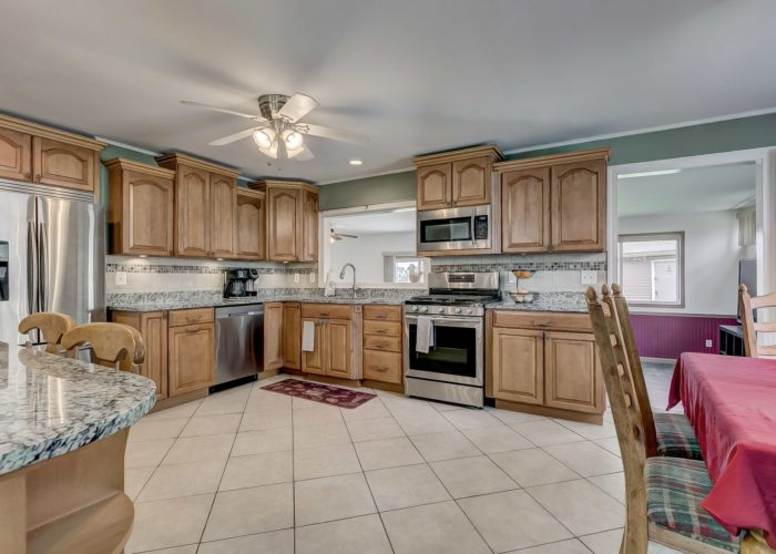 8134 Bullneck Road, spacious kitchen with ceiling fan