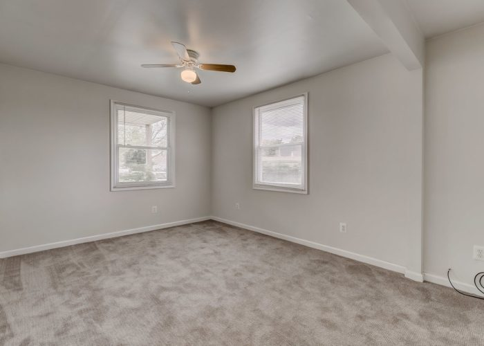 8134 Bullneck Road, gray carpet and ceiling fan in bedroom