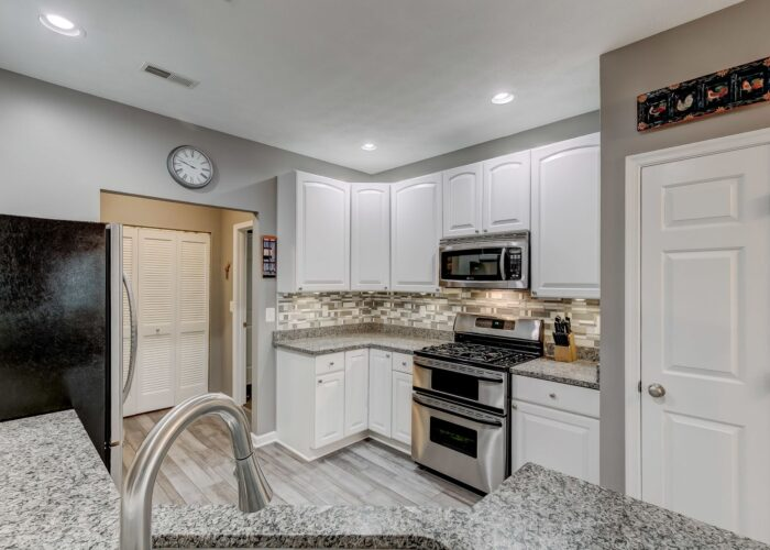 9505 Kingscroft Terrace #M, kitchen with granite counters