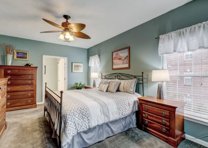 9505 Kingscroft Terrace #M, owner's suite bedroom with windows and ceiling fan