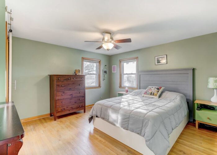 9502 Buckhorn Road, first bedroom with ceiling fan