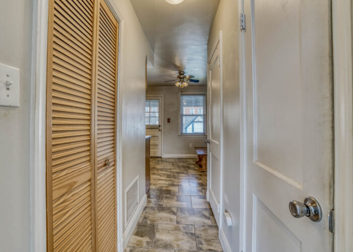 1904 Searles Rd., hallway with door shut to washer and dryer