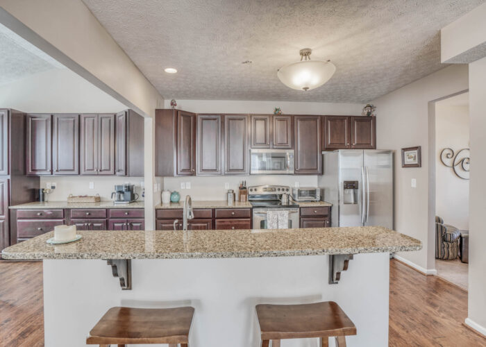 214 Steed Lane, breakfast bar looking into kitchen with stainless appliances