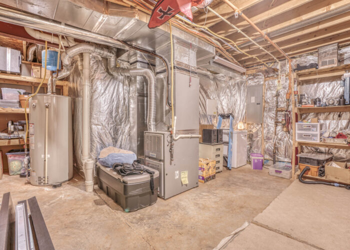214 Steed Lane, basement showing furnace and hot water heater