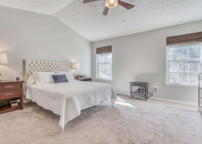 214 Steed Lane, primary bedroom with ceiling fan