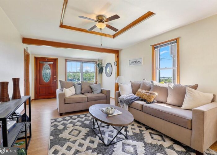 7312 Bay Front Road, living room with ceiling fan
