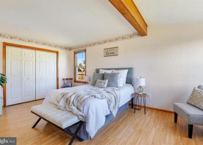 7312 Bay Front Road, primary bedroom with exposed beam