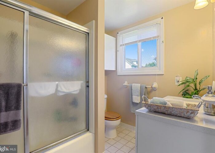 7312 Bay Front Road, bathroom showing stall shower