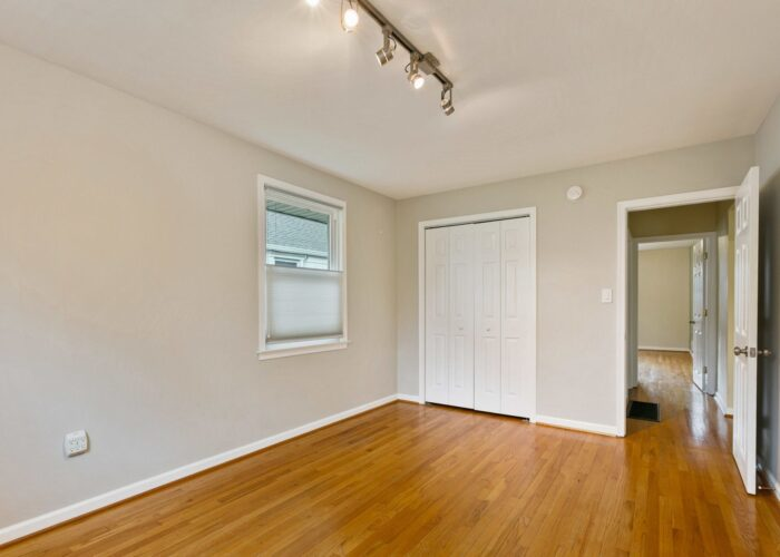 6716 Old Harford Road, first bedroom with track lighting