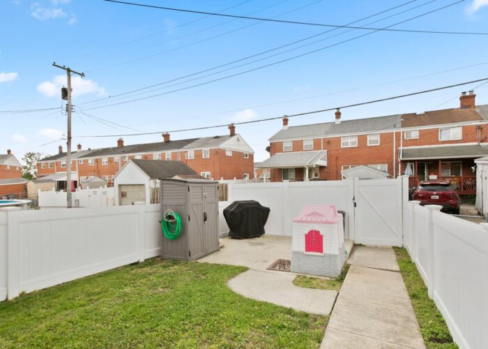 8054 Wallace Road, fenced yard with back gate