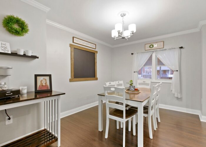8054 Wallace Road, dining room with ceiling fixture and window