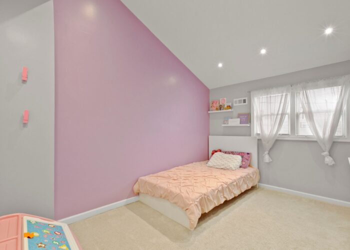 8054 Wallace Road, second bedroom with vaulted ceiling