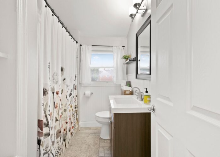 8054 Wallace Road, long view of full bathroom