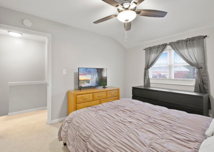 8054 Wallace Road, first bedroom with ceiling fan