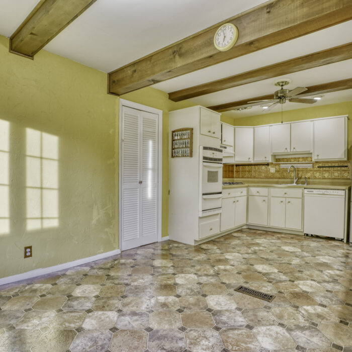 2502 Lampost Lane, kitchen with white cabinets