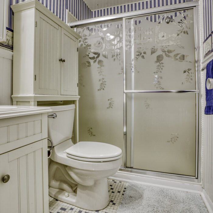 2502 Lampost Lane, bathroom with striped wallpaper and shower