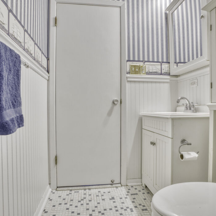 2502 Lampost Lane, bathroom with striped walls