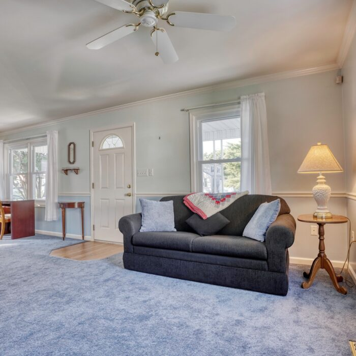 2803 Page Drive, living room with ceiling fan