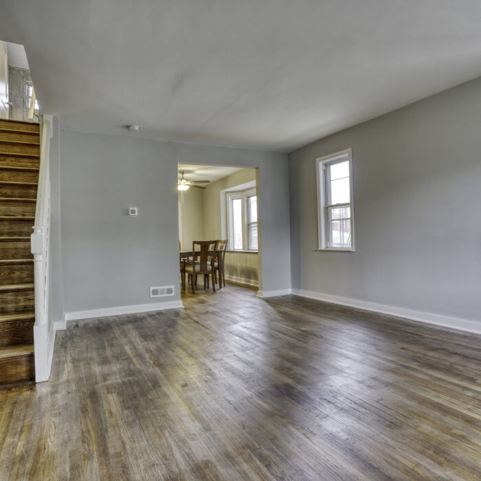 627 Dunwich Way, living room showing stairs leading up
